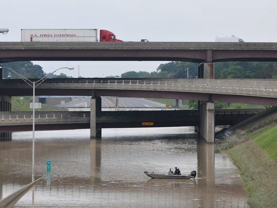 Road investigators survey the support pillars at the I-75 and I-696 interchange in Royal Oak on August 12, 2014.