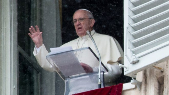 Pope Francis speaks to faithfuls from his apartment during the Sunday Angelus prayer in Saint Peter's square on Sunday.