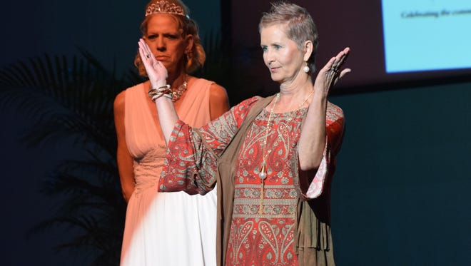 Ten-month breast cancer survivor Colynda Byrnes (front) models an ensemble from Sassy Girl at the 2015 Threads fashion show held Sunday at the Coughlin-Sauders Performing Arts Center. This was Byrnes first time participating in the show. Also modeling was Crystal Shone (back).