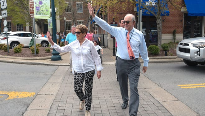 Franklin Mayor Ken Moore and his wife, Linda, lead a Walk with the Mayor event in downtown Franklin.