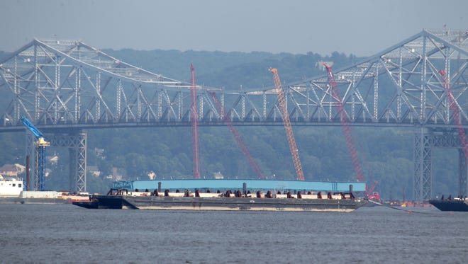 A girder assembly for the new Tappan Zee bridge sits on a barge next to the bridge June 10. The girders were assembled at the Port of Coeymans, near Albany, and traveled down the Hudson River on the barge. It arrived at the bridge June 10.