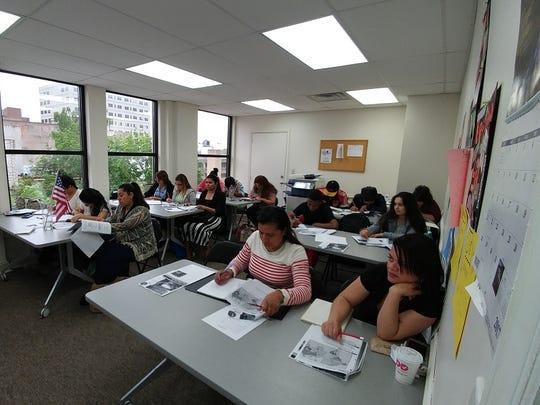 Immigrant students honing their spoken and written English skills at a YWCA Princeton's Latinas Unidas' English as a Second Language (ESL) program.