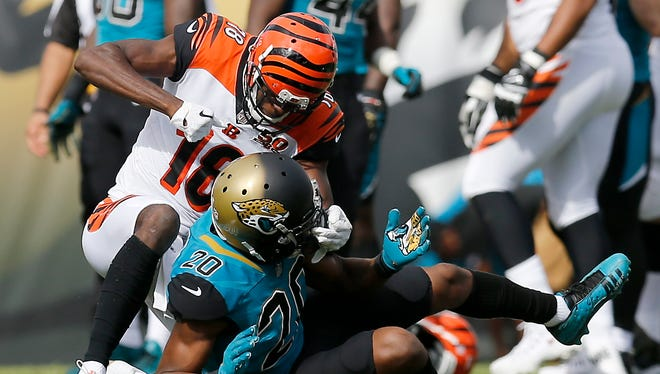 Cincinnati Bengals wide receiver A.J. Green (18) throws a punch at the helmet of Jacksonville Jaguars cornerback Jalen Ramsey (20) after pulling him to the ground after a play in the second quarter of the NFL Week 9 game between the Jacksonville Jaguars and the Cincinnati Bengals at EverBank Field in Jacksonville, Fla., on Sunday, Nov. 5, 2017. At halftime the Bengals trailed 10-7 after wide receiver A.J. Green was ejected for throwing a punch.