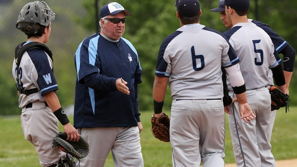 Westlake coach John Consorti talks to his team on the mound during a game at Valhalla High School May 17, 2016.