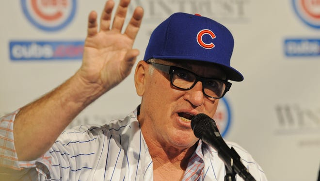 Joe Maddon took the Cubs' offer of five years and $25 million.