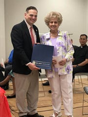 Sen.Nicholas P. Scutari (left) presented a ceremonial resolution to Gloria Nisky (right) for being named Linden 2018 Outstanding Senior Citizen of the Year on Friday, May 4.