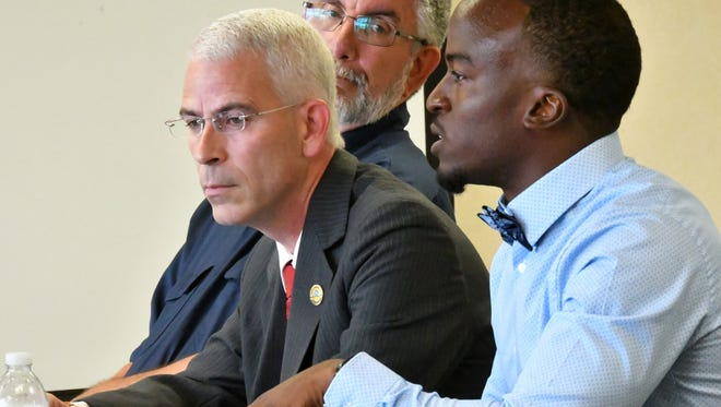 Palm Bay City Councilman and Deputy Mayor Tres Holton (center) is accused of having his mother secretly record petition gathers at a June 1 event. On Holton's left is his Republican opponent Thomas Gaume and on the far right is his Democrat opponent Kenny Johnson.