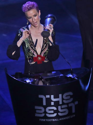 United States forward Megan Rapinoe receives the Best FIFA Women's player award during the ceremony of the Best FIFA Football Awards, in Milan's La Scala theater, northern Italy, Monday, Sept. 23, 2019. (AP Photo/Antonio Calanni)