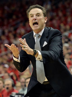 Louisville Cardinals head coach Rick Pitino reacts during the second half against the Georgia Tech Yellow Jackets at KFC Yum! Center. Louisville defeated Georgia Tech 56-53.