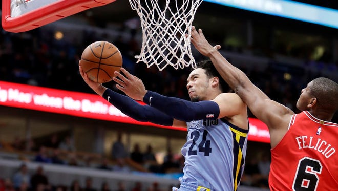Memphis Grizzlies' Dillon Brooks (24) shoots past Chicago Bulls' Cristiano Felicio during the first half of an NBA basketball game Wednesday, March 7, 2018, in Chicago. (AP Photo/Charles Rex Arbogast)