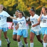 Teammates celebrate after one of the Rebels' eight goals against Cooper Sept. 23. They are, from left, Peyton Black, Hannah Tharpe, Skylar Lehmkuhl, Paige Mersmann, Ryielan Hamilton and Stephanie Schwartz. Players in the picture accounted for five of the goals.