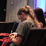 Students listen to the story of David and Goliath at the Central Florida Wesley Foundation's Tuesday service.