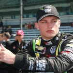 Rookie, Sage Karam, in the pit area prior to qualifying at the Indianapolis Motor Speedway, Sunday, May 18, 2014.