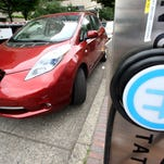 A Nissan Leaf charges at a electric vehicle charging station in Oregon.