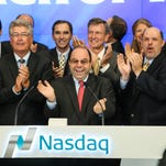 Helen of Troy CEO Julien Mininberg and other officials with the El Paso company celebrate ringing the opening bell Monday on the Nasdaq stock exchange in New York.