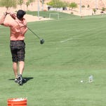Rick Lukas, left, and Tommy Keith compete in the men's 55-59 age division at the long drive competition.