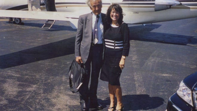 Wiesel and Hoskins by the private jet in Connecticut that flew the famed author, Nobel laureate and Holocaust survivor to Kentucky in 2005.