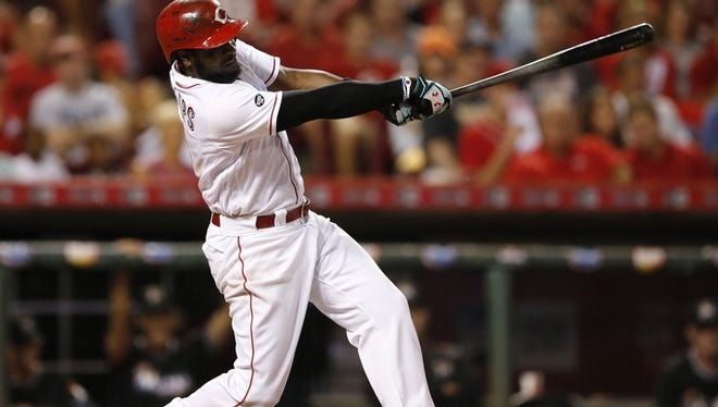Reds infielder Brandon Phillips drives in the game-tying and go-ahead runs with a double in the 7th inning.