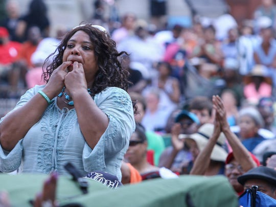 A spectator shows appreciation for the music during the 27th DuPont Clifford Brown Jazz Festival Saturday at Rodney Square in Wilmington.