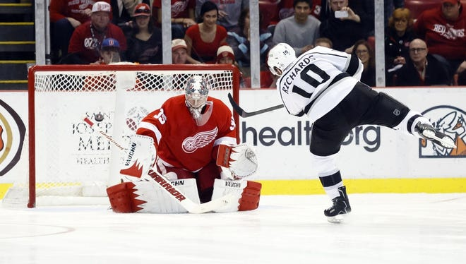 Detroit Red Wings goalie Jimmy Howard (35) makes a save on a shot by Los Angeles Kings center Mike Richards (10) in the shoot-out at Joe Louis Arena on Jan. 18, 2014.