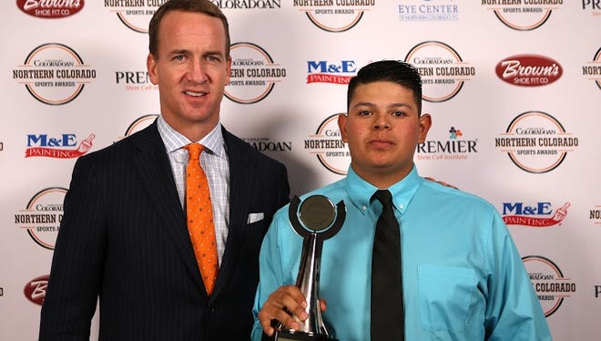 NFL MVP quarterback Peyton Manning is pictured with Baseball Player of the Year Austin Alarid.