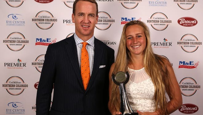 NFL MVP quarterback Peyton Manning is pictured with Girls Soccer Player of the Year Gabriella McDonald.