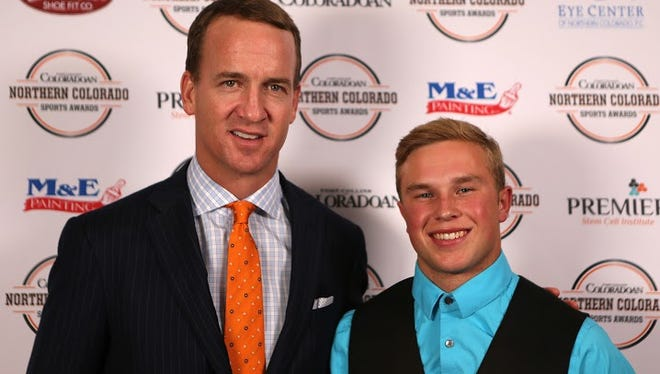 NFL MVP quarterback Peyton Manning is pictured with Male Athlete of the Year Landon Schmidt.