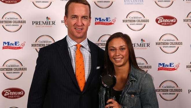 NFL MVP quarterback Peyton Manning is pictured with Female Athlete of the Year Tatum Rembao.