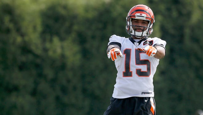 Mario Alford waves off the ball during punt return drills at the Bengals rookie camp. It's part of his game the rookie the needs to develop.