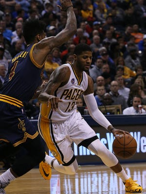 Indiana Pacers forward Paul George (13) drives past Cleveland Cavaliers guard Iman Shumpert (4) in the first half of the game at Bankers Life Fieldhouse, Indianapolis, Wednesday, April 6, 2016.