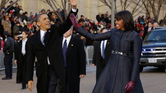 First Lady Michelle Obama paired a shiny J. Crew sash