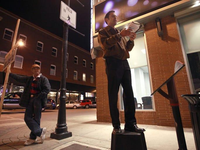 Downtown street preacher Aaron Brummitt uses a battery-powered