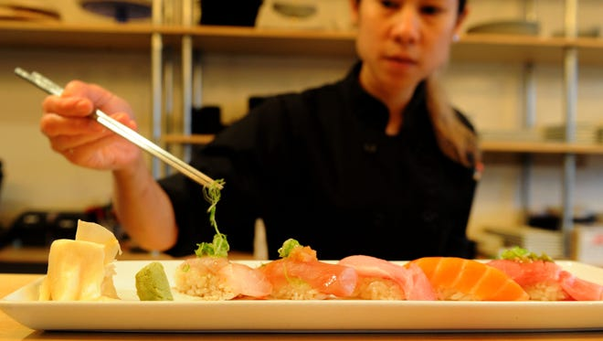 Sushi chef Polly Srisiri prepares a dish at the Prawn & Basil in Thousand Oaks.