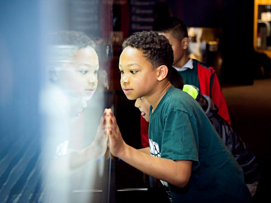 The Adventure Science Center lets visitors experience hands-on displays for interactive learning.