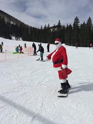 Santa is seen here hitting the slopes at Ski Apache before the big Christmas rush.