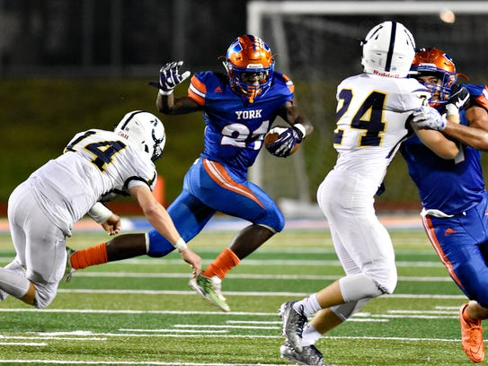 York High running back Khalid Dorsey (21) makes a move on a defender during York High vs Cedar Cliff football action at Smalls Field in York City, Friday, Sept. 15, 2017. Dorsey capped his high school career with a senior season that saw him gain 1,728 rushing yards, 15 touchdowns and get named as a first-team all-star in Division I. Dawn J. Sagert photo
