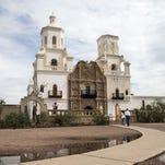 Masons work to restore San Xavier del Bac