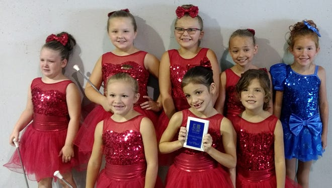 Americettes Primary Red From left, front, areArian Greene, Joslynn Hensley, Summer McKenna; and back Avery Babcock, Rilee DeJean, Clara Tomlin, Jennifer Craft, Addison Pelter.