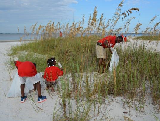 636398620759735088-Sea-oats-cleanup.jpg