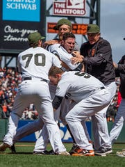 Teammates try to escort San Francisco Giants relief pitcher Hunter Strickland,  center facing, off the field after a fight against the Washington Nationals during the eighth inning at AT&T Park on Monday, May 29, 2017.