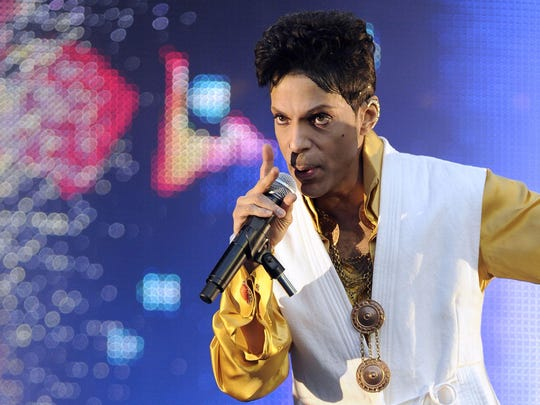 This June 30, 2011 file photo shows Prince performing on stage at the Stade de France in Saint-Denis, outside Paris.