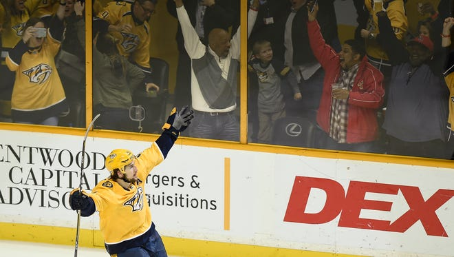 Predators left wing Filip Forsberg (9) celebrates his penalty shot goal during an overtime period to win over the Blues 4 to 3 at Bridgestone Arena Tuesday, Feb. 13, 2018 in Nashville, Tenn.