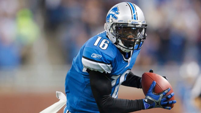In this Dec. 11, 2011, photo, Detroit Lions wide receiver Titus Young makes a catch for a touchdown during an NFL football game against the Minnesota Vikings in Detroit.
