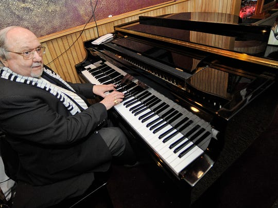 Jess Ellison plays the piano at Theo's in downtown