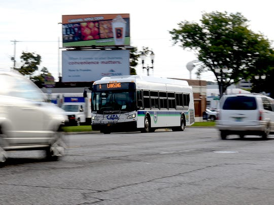A CATA bus on Route 1 heads west on Michigan Avenue toward downtown Lansing Wednesday, Sept. 28, 2016, on its way back to the CATA station on Grand Avenue.