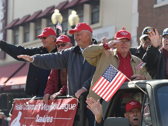 Veterans ride on a truck supported by the Halls Crossroads Women's League during the Veterans Day parade through downtown Friday, Nov. 11, 2016. The two-hour event saw almost 100 participating units and thousands of parade watchers.