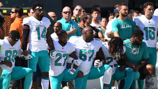 Some of the Miami Dolphins take a knee during the anthem prior to the game against the New York Jets last season.