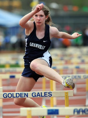 Granville's Isabella Yeager competes in the shuttle hurdles during the Fulton Relays on April 22.