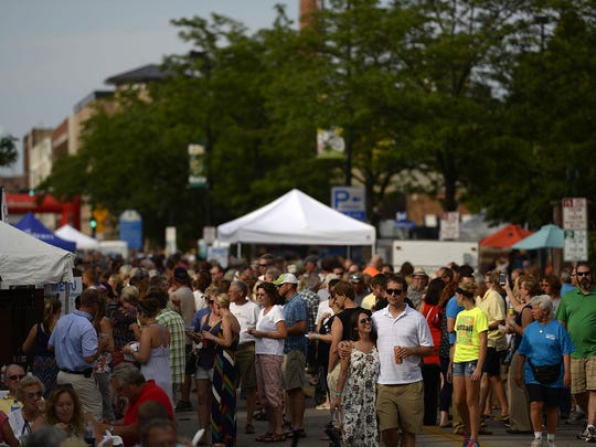 Festivalgoers enjoy 2014's Taste On Broadway, a celebration of food from Green Bay area restaurants and Wisconsin beer and wine.