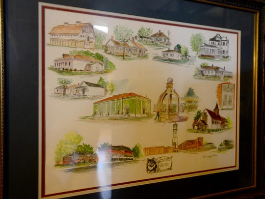 The original 'History of Bemis' painting hangs in the home of local artist, and owner, Rosalee Gibbons.